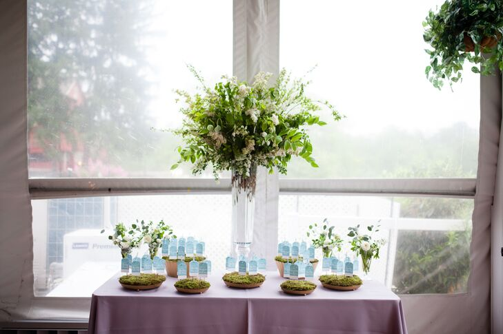 Instead of the standard escort cards, Caitlin and Hugh tied theirs in to the wedding's garden-inspired theme. Hand-lettered, watercolor gift tags made by Jessica Stalnaker of Empress Stationery were hung on pint-sized silver shepherd's hooks and displayed in copper planters filled with earthy moss. The cards' design matched the wedding invitations', giving the day a cohesive feel.