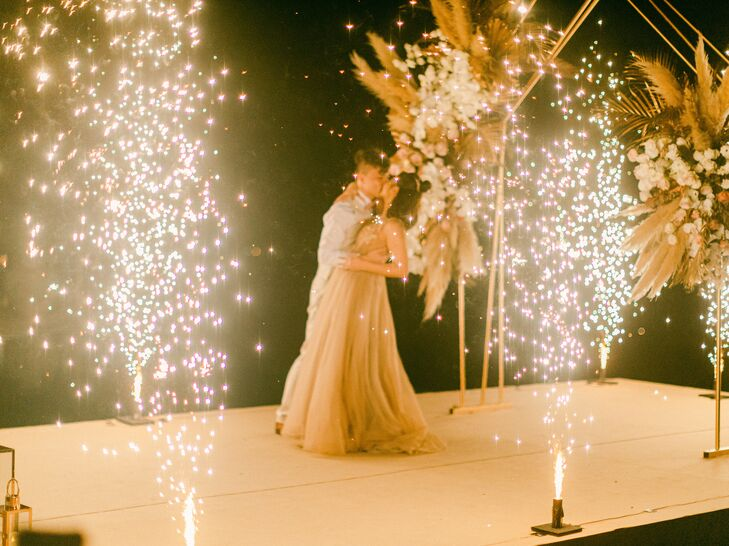 """For Suki and Sing's """"boho luxe"""" wedding in Phuket, Thailand, the couple chose an earthy color palette with metallic accents threaded throughout. A, """"m"""