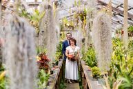 For their summer wedding, Leah	Reisman and Tom Gartner were inspired by the brilliant colors of Shelldance Orchid Gardens, and they designed their cer