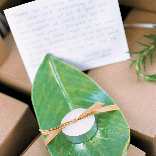 As soon as they were engaged, Diane set to making 200 ceramic plates, which she pressed and shaped like peace lily leaves and then stamped with the wedding day design. She glazed each one with a green alligator glaze and tied them with a tea candle, as favors for her guests. The ceramic plate favors were attractively packaged in natural ivory boxes tied with white ribbon and a sprig of rosemary (a symbol for fidelity).