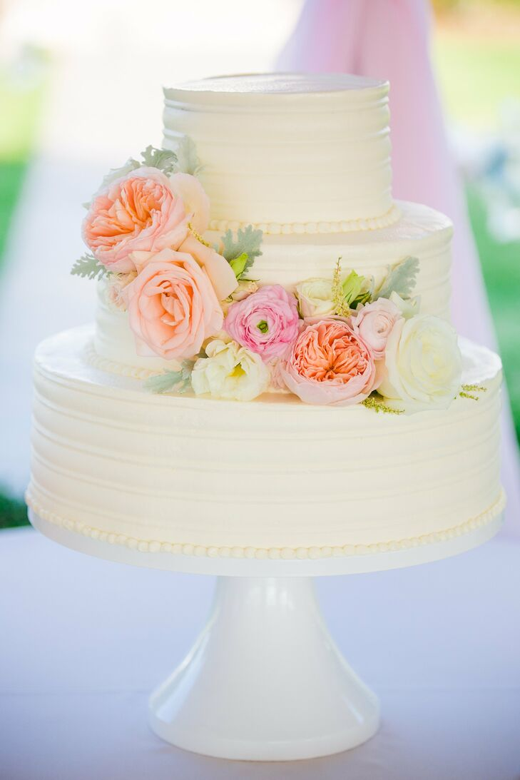 Although they had multiple cake tastings planned, when Haley and Dillard sampled a champagne cake with a wild strawberry filling, their decision was made. The three tiers were iced in white and fresh blush-colored flowers and were placed around the middle tier.