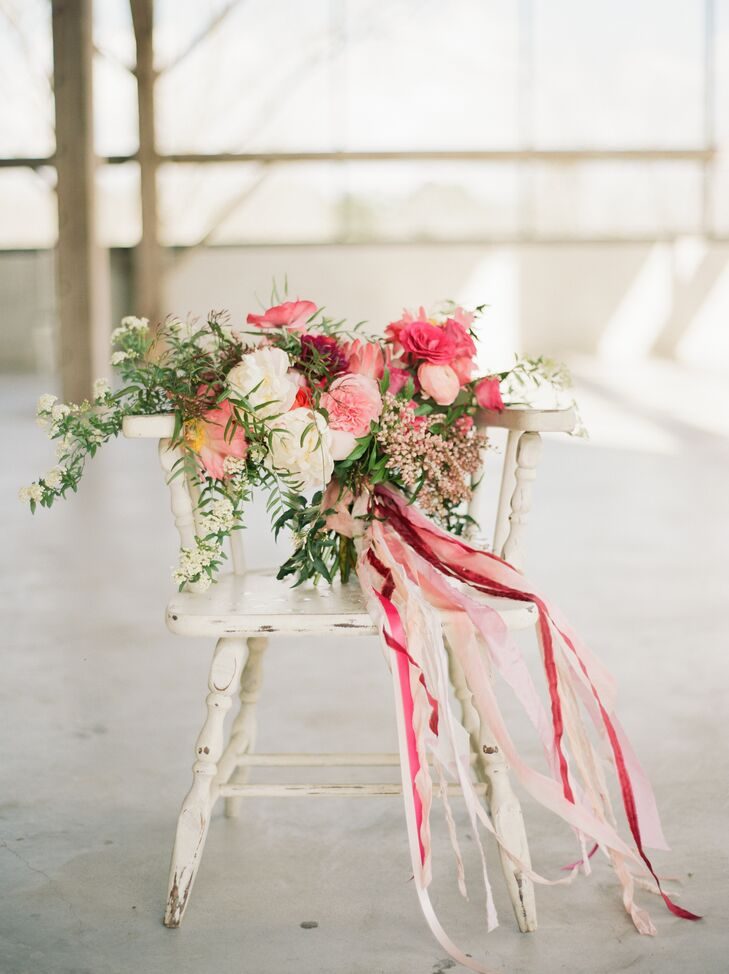 """""""My bouquet was not only lovely in colors but also huge—just the way it should be in Texas,"""" says Deborah, who had Flower Vibes create a colorful arrangement in varying shades of pink with king proteas, ranunculus, anemones, garden roses and peonies."""