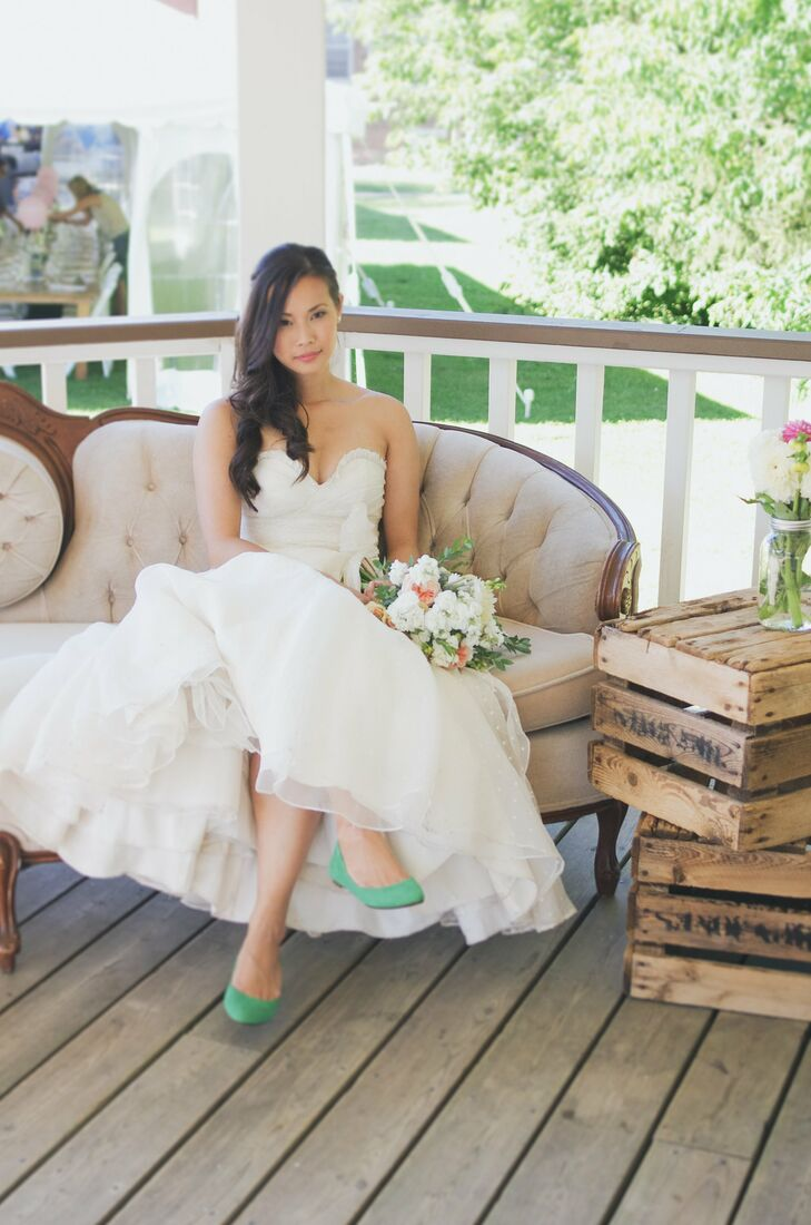 Zurry's ivory fit-and-flair dress was made from dotted swiss silk organza. The gown featured a sweetheart neckline and a vintage-inspired dotted silk sash. Mint green flats added a fun vibrant touch to her look.