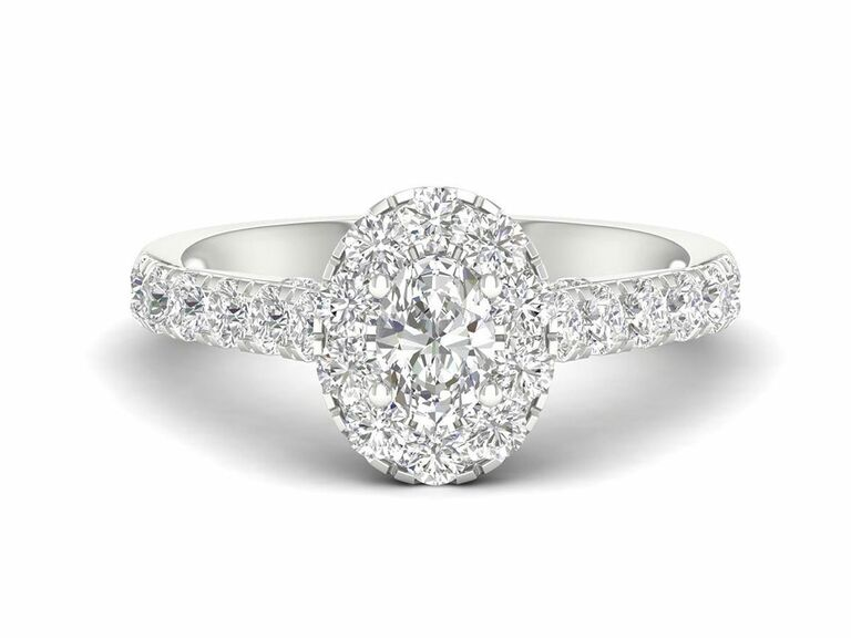 Jenny Packham oval cut diamond engagement ring with diamond halo setting and diamond pave band