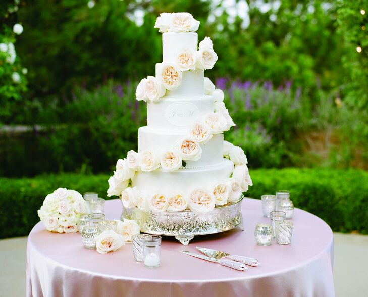A trail of white roses wound around the layers of the classic five-tiered cake. Inside, there was a filling for Jessica and Matt each—Oreo cookie and raspberry!