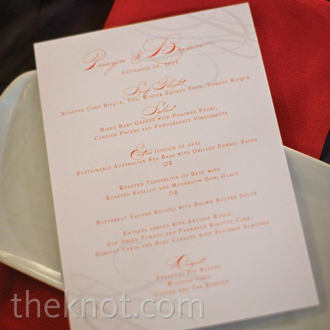 Orange cursive font and a subtle gray swirl pattern dressed up the simple white menu cards.