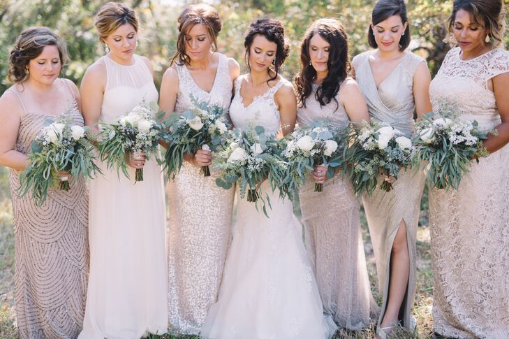 """Oriana asked her bridesmaids to wear long gold or champagne dresses. """"That was my only instruction,"""" she says. """"They looked beautiful together, and I'm so happy I didn't panic or think too much about the colors or styles not blending. Plus, they were all comfortable in the dresses they chose."""""""