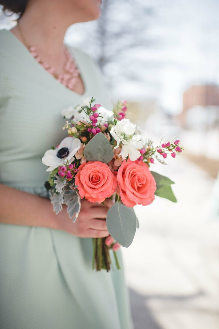 Coral and white bouquets matched the mint bridesmaid dresses. They consisted of roses, anemones, stock and scabiosa.