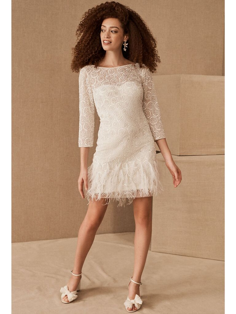 White embellished midi dress with three-quarter length sleeves and feathered hemline