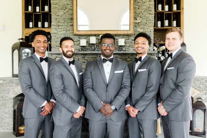 Chris and his groomsmen looked dapper in gray Vera Bradly gray tuxedos and black bow ties.