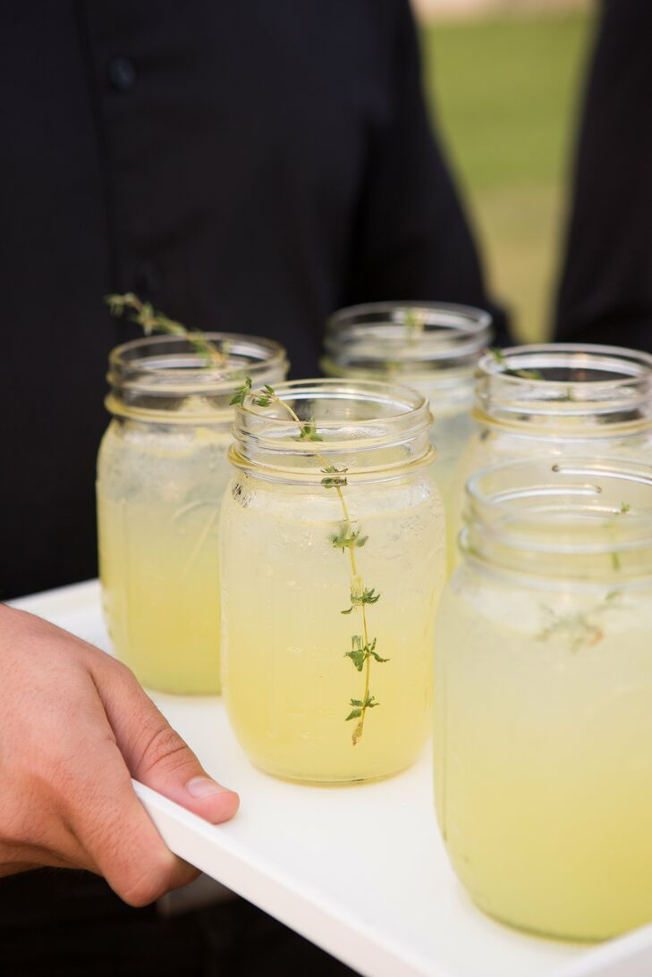 The cocktail hour took place inside the cocktail tent which was transformed with comfortable outdoor lounge furniture to give it a laid-back vibe. Signature drinks such as the Ginger Mojito and the Sage Lemonade were served in mason jars.