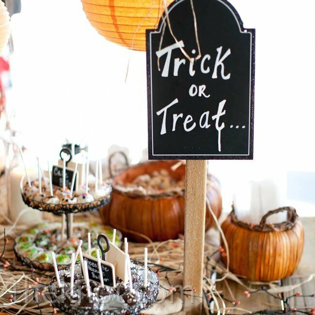 Since the wedding date was close to Halloween, a Trick or Treat sign by the dessert bar was a no-brainer.