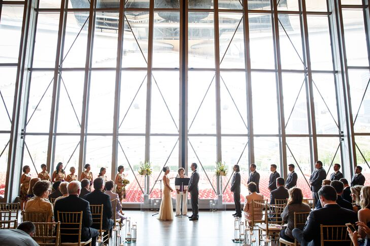 "The mid-afternoon ceremony was held on the Pritzker Pavilion Stage in downtown Chicago. ""It was up to Jim and I whether we wanted the stage doors open or closed, so we decided to keep them closed for the ceremony to help with sound,"" Andrea says. ""I'm so glad we did, because it helped our voices be heard and made the space feel more intimate."""