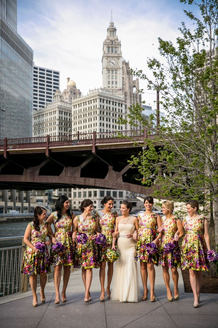 "Each of Andrea's seven bridesmaids wore a floral print Donna Ricco dress bought off the rack at Nordstrom. ""I instantly loved the colors and print and used the palette as the inspiration for our entire wedding,"" Andrea says."