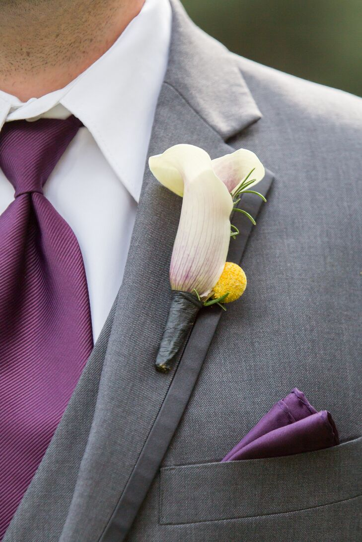 The groom pinned a calla lily and craspedia boutonniere on his classic Vera Wang Collection gray tuxedo from Men's Warehouse.
