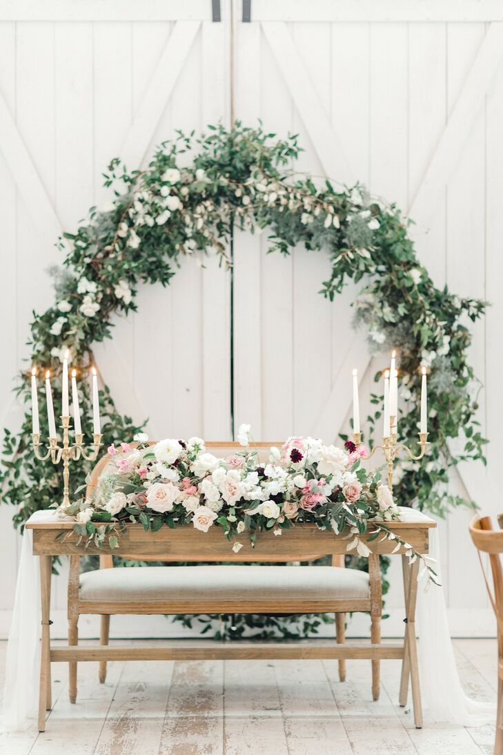 Romantic Sweetheart Table with Candelabras, Floral Arrangement and Wreath Backdrop