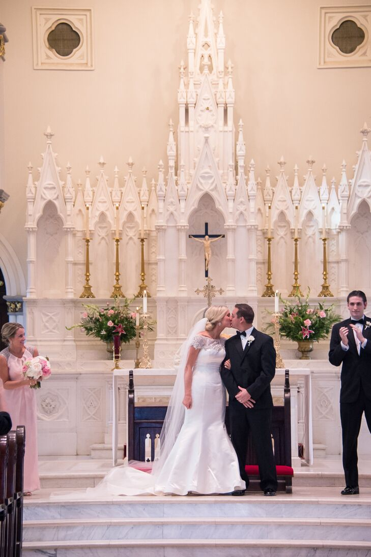 """The ceremony at St. John's Cathedral was incredibly special,"" says Caitlin. ""We had such a wonderful experience with our wedding preparation that the vows were even more special!"""
