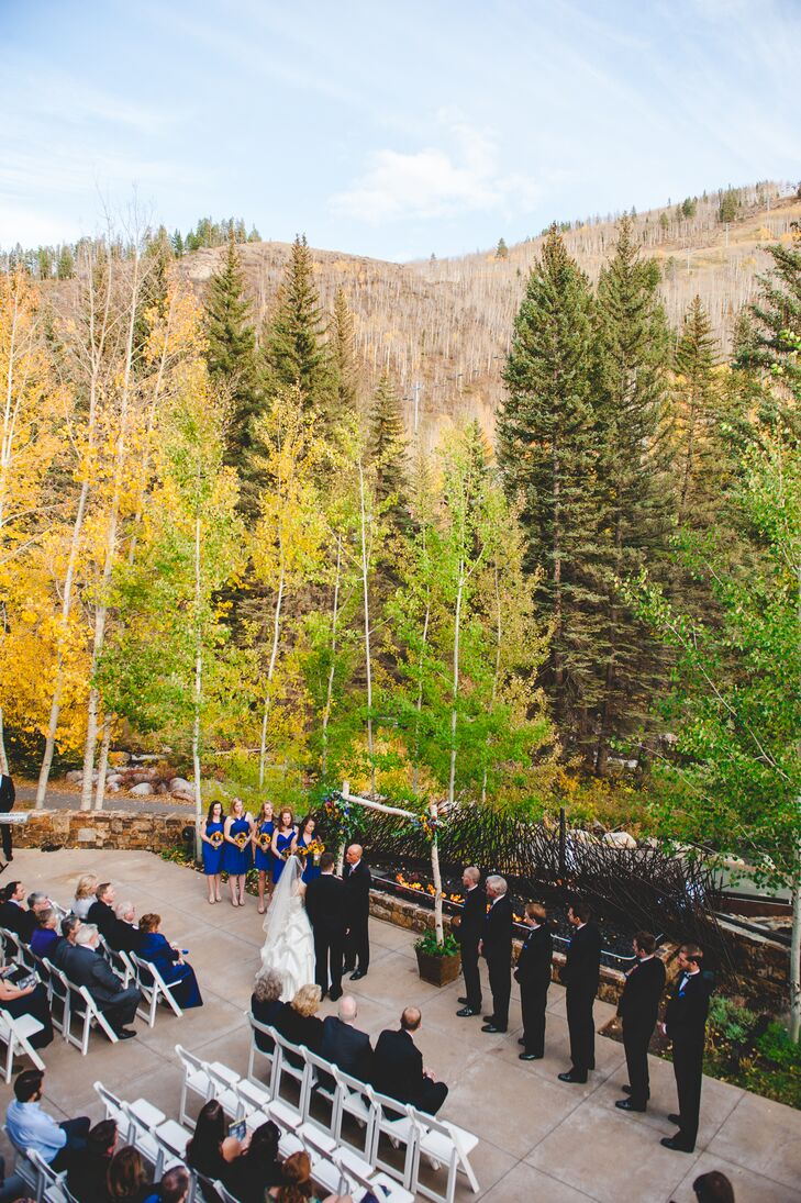 """I've always wanted an outdoor wedding in the fall (my favorite season!),"" Kimberly says. ""The outdoor backdrop of the Cascade deck was absolutely breathtaking—especially in October with the golden Aspen leaves fluttering and falling all around us as the mountain creek rushed by ahead of us. God couldn't have painted a more colorful, amazing outdoor portrait for us!"""