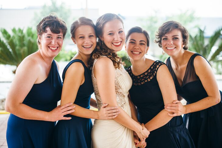 """The bridesmaids chose their own knee length navy dresses. """"Their dresses captured my love for simple elegance, and they all loved what they wore!"""" says the bride."""