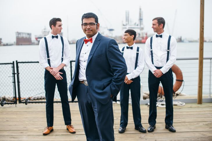 To be dressy casual and comfortable in the Texas heat, the groomsmen wore navy pants and white shirts with matching navy suspenders.