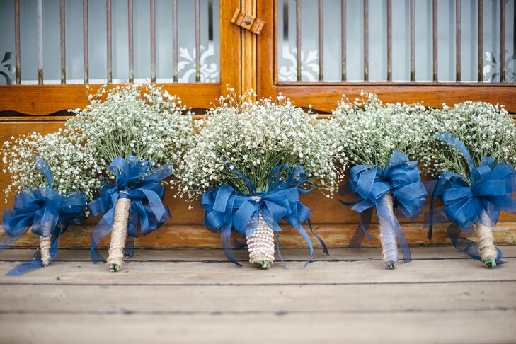 """""""I love baby's breath, and I love how they look by themselves,"""" says the bride. Having simple, baby's breath bouquets made the floral DIY both easy and affordable."""
