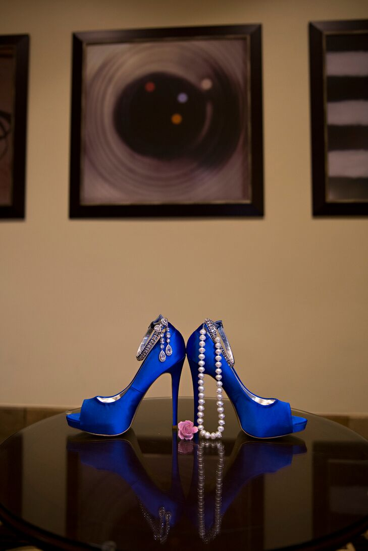 Jess complemented her wedding dress with blue peep-toe heels and a string of pearls.