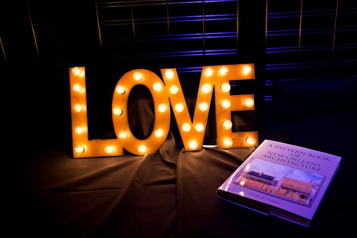 """The couple accented their candy bar with a lighted """"Love"""" sign."""