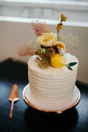 Ridged Buttercream Cake with Cake Flowers and Lemon Decoration