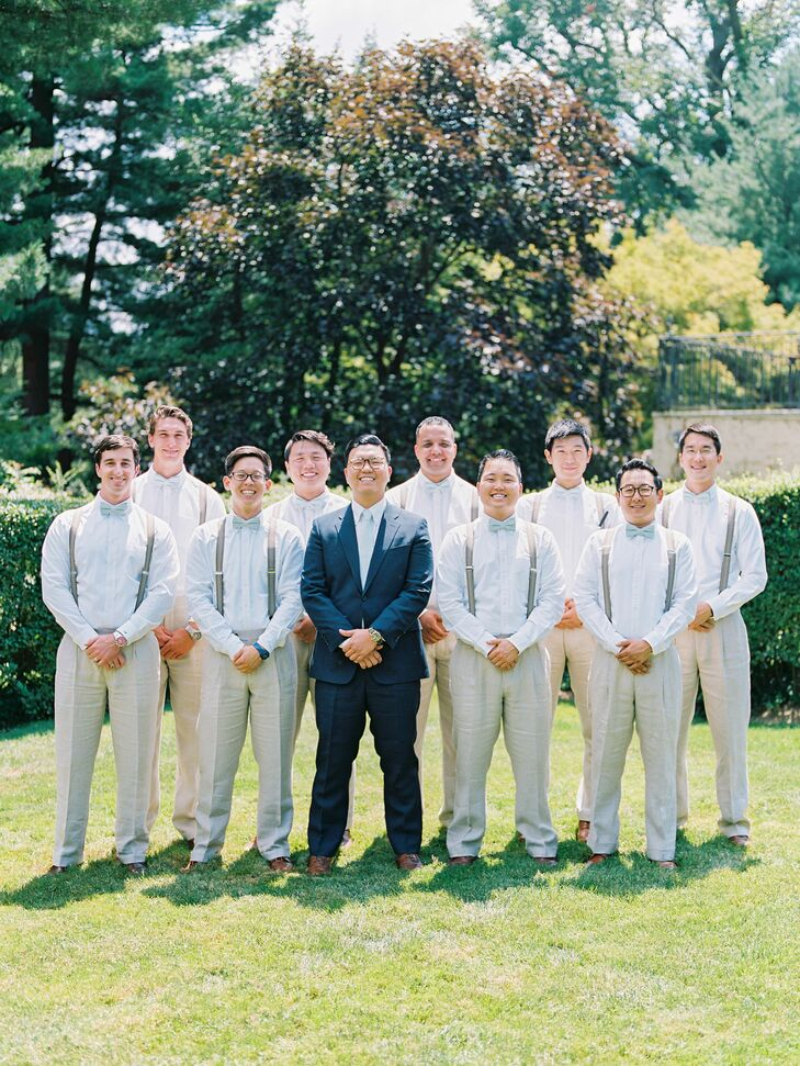 To contrast Uesin's sharp navy Ralph Lauren suit, the groomsmen sported khaki trousers, classic white button-downs, suspenders and bow ties for a low-key summery look.