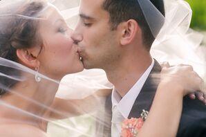 Newlyweds Kiss Under the Bride's Veil