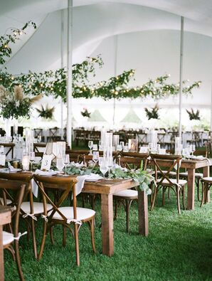 Tented Reception with Wooden Farm Tables and Greenery