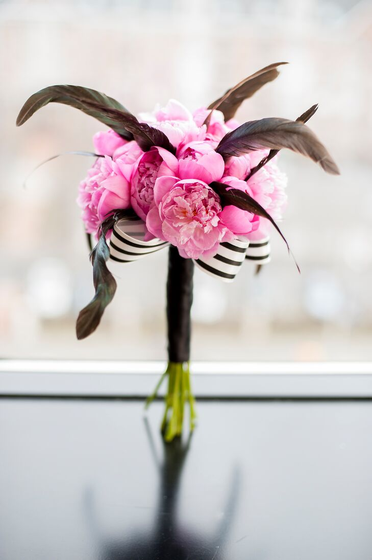 Emily carried a bouquet of pink peonies with feather accents and a black and white striped ribbon.