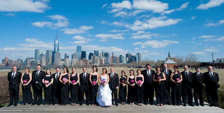 Emily's bridesmaids wore long black dresses and carried pink bouquets while Corey's groomsmen wore class black tuxedos with pink boutonnieres.