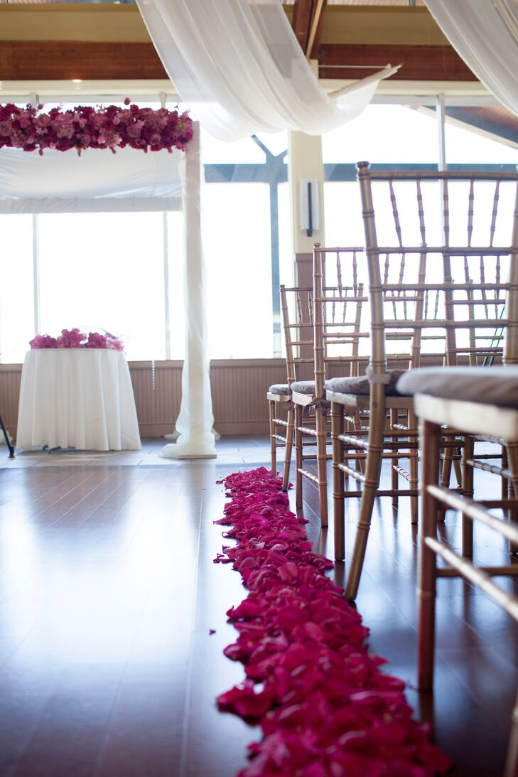 Bright pink rose petals lined the ceremony aisle at the Liberty House Restaurant.