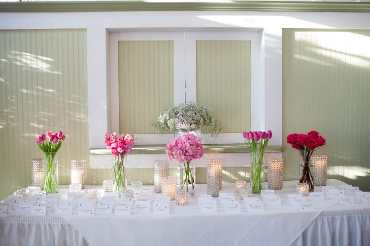 Place Card Table with Pink Bouquets and Candles