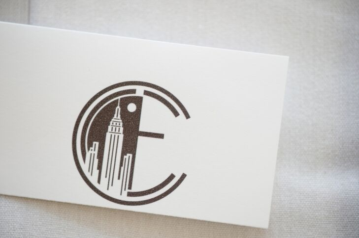 Emily and Corey worked with a graphic designer to created a personalized logo combining their names with an outline of the New York City skyline.