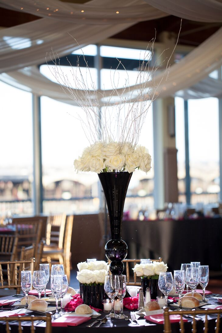 Centerpieces were all white roses with some arrangements in tall black vases and others in short rectangular holders.