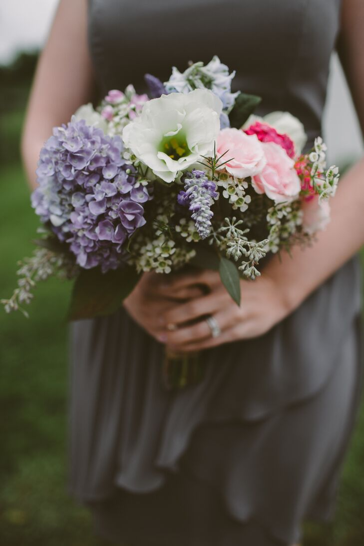 The bridesmaids carried pastel bouquets with lisianthus, roses, hydrangeas and seeded eucalyptus.