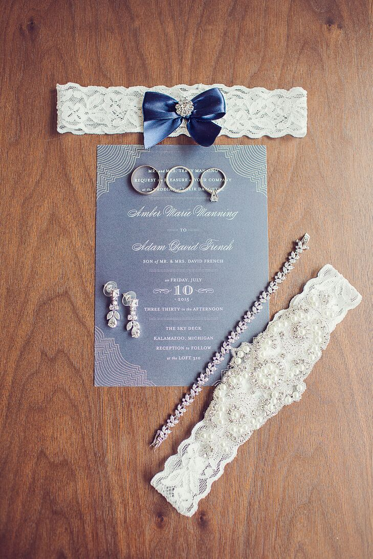 The wrapping on Amber's bouquet was a slice of lace that was cut from her mother's wedding dress. Her sister-in-law gave her a charm pin, which represented something old, something new, something borrowed and something blue.
