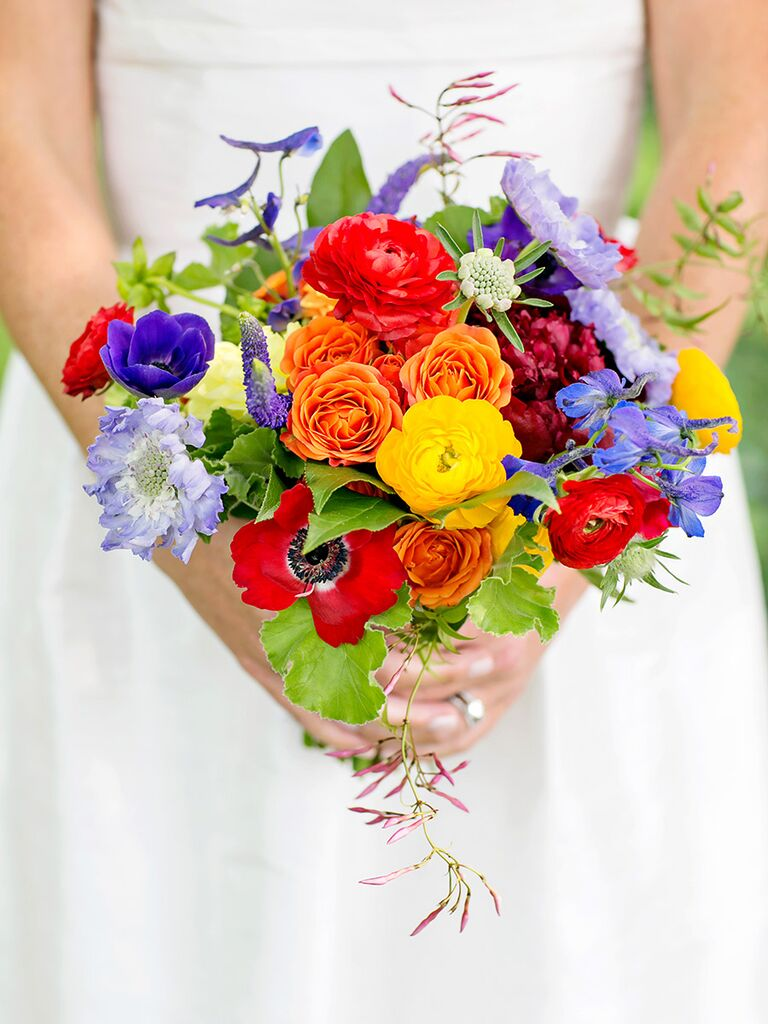 Bright bouquet with anemones, scabiosa and ranunculus