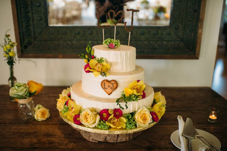 The couple's wedding cake was designed to look like a tree with their initials carved out of it.