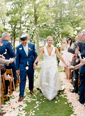 Couple Recessing at Guests Toss Rose Petals
