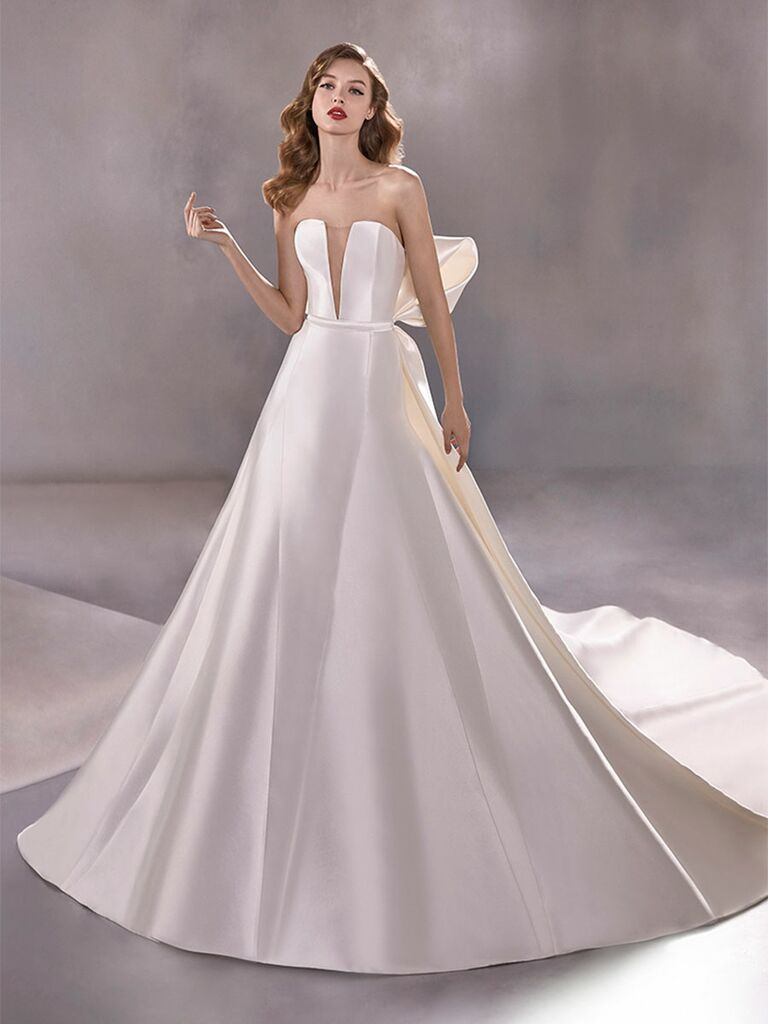 Atelier Provonias wedding dress plunging ball gown with detachable back bow