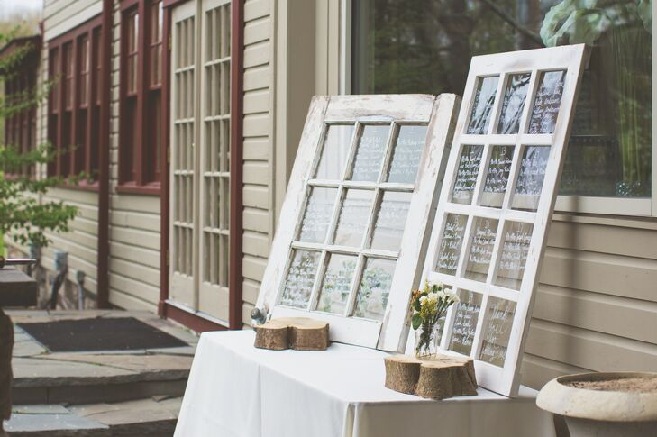 The Seating Charts At Reception Were Handwritten By Laura On Window Panes Of A