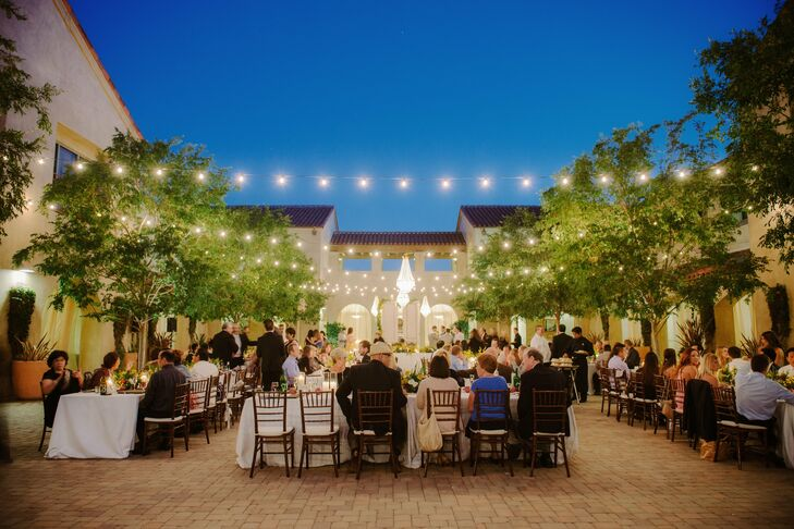 Festive bistro lights were strung over the reception space and cast a warm ambient glow.