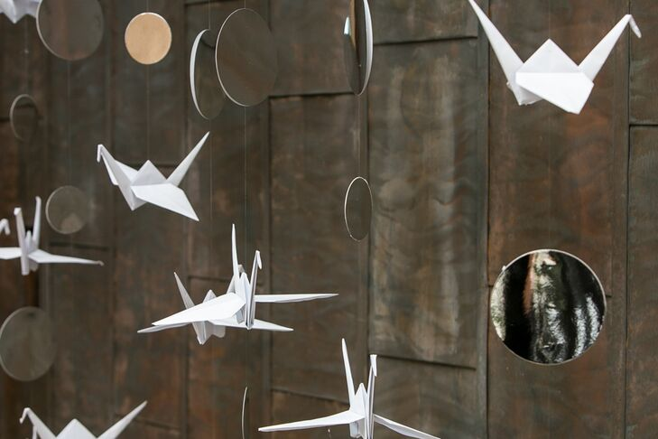 """Marla created a hanging crane installation with a friend. """"It became the focal point of the day,"""" Marla says. """"Guests started taking photos in front of it."""""""