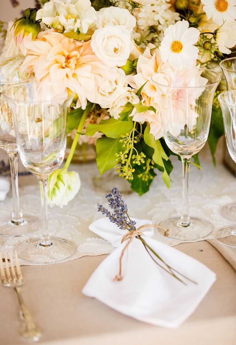 Simple white and cream place setting with lavender sprig
