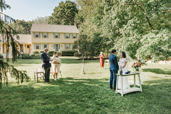 Vow Exchange During Backyard Minimony in Reading, Massachusetts