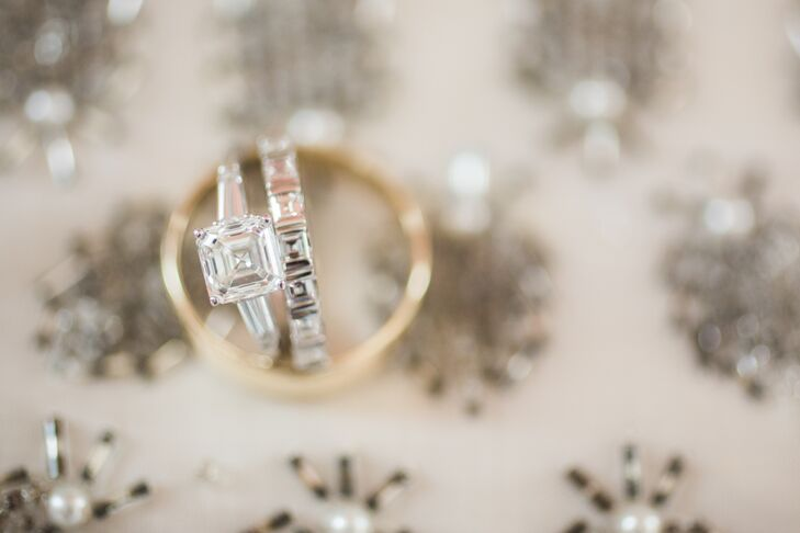 """In the end, we used small asscher-cut diamonds with an illusion setting between each stone. I am thrilled with the result, and know it is something I will cherish for a lifetime,"" Ivy says. ""Mark's ring was pretty much a copy of his dad's—a simple gold band. I never knew Mark was such a stickler for tradition, but he really just wanted what he grew up seeing on his dad! I had it engraved with my initials and the wedding date as a little surprise."""