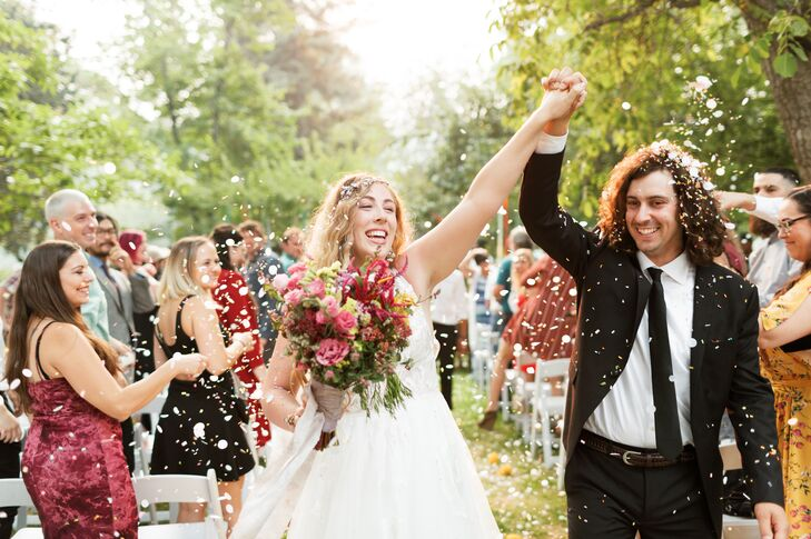 At Kelly and Gordon Casey's local farm wedding, the couple chose a 1960s and 1970s bohemian theme with lots of rich, bright colors. Kelly wore an ivor